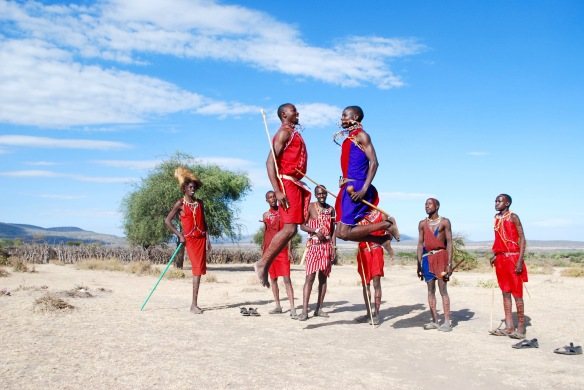 Masai men jumping as high as they can, an ancient tradition meant to attract the ladies.